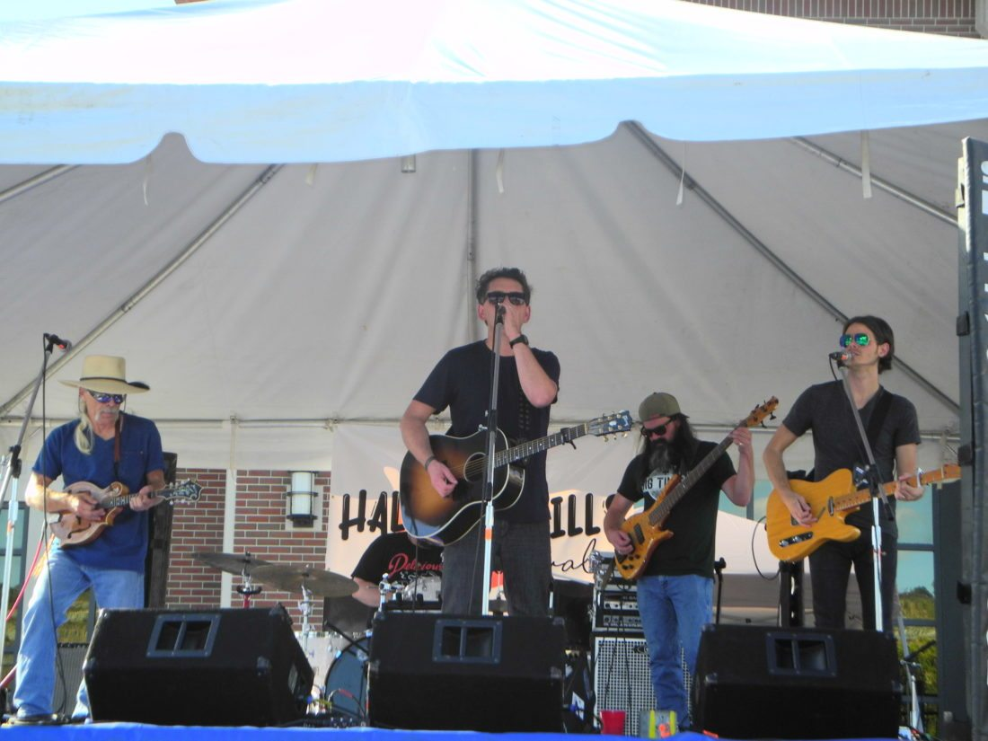 HALF HILLS FESTIVAL — The Joe Zelek Band brought its country sound to the Half Hills Music Festival on Third Street in Steubenville Saturday. The band is among 15 musical acts of various styles appearing at the new event, which offers a mix of music, art, food and activities. It continues from noon into the early evening today at Third Street and Historic Fort Steuben's Louis Berkman Amphitheatre.