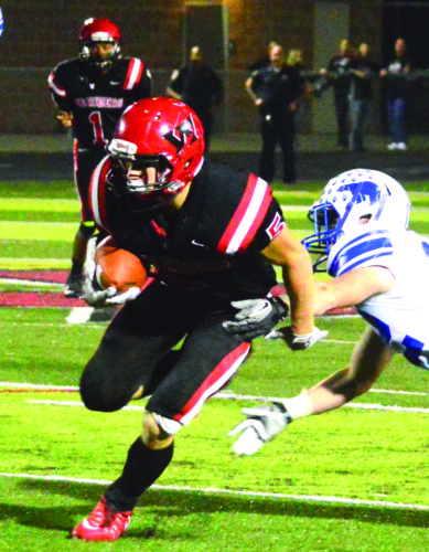 SPREADING THE FIELD — Weir's Chad Custer rushes against Fairmont Senior on Friday (Photo by Michael D. McElwain).