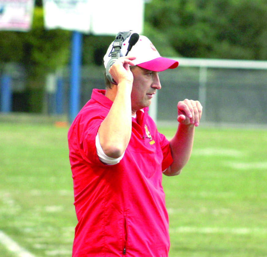 MAKING THE CALL — Indian Creek head coach Andrew Connor reacts against East Liverpool on Sept. 1 (Photo by Joe Catullo).