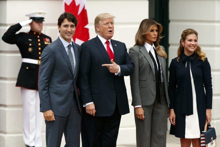 VISITORS FROM CANADA — Canadian Prime Minister Justin Trudeau, left, and his wife Sophie Gregoire Trudeau, right, stand with President Donald Trump and first lady Melania Trump after arriving at the White House in Washington Wednesday. -- Associated Press