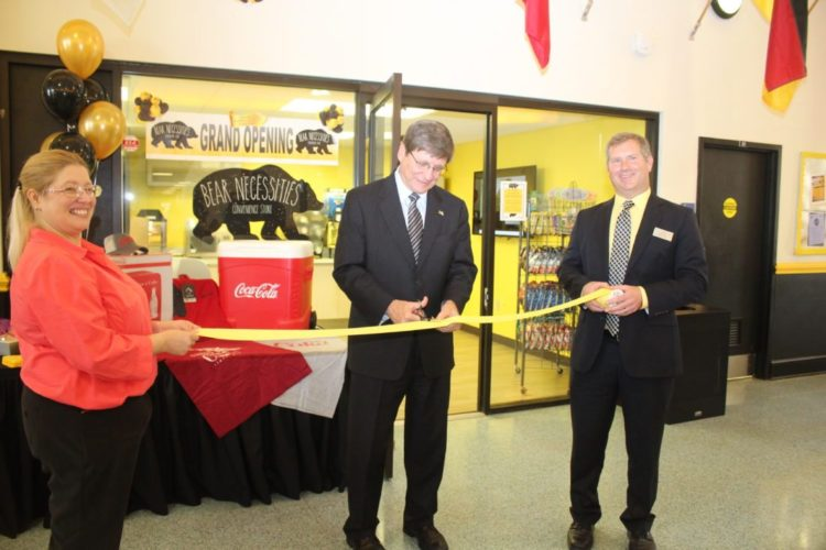 NEW STORE AT WLU — Cutting a ribbon Tuesday to mark the opening of a new convenience store inside West Liberty University's College Union are, from left,  Anita Hardin of Sodexo, WLU President Stephen Greiner and Sodexo General Manager Doug Orr. - Contributed