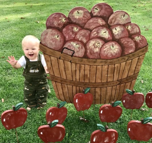 COME TO UNIONPORT — William Ault, 11-month-old son of Tom and Anna Ault, poses in front of Apple Stirrin' artwork and is ready for the 39th-annual festival Saturday and Sunday in Unionport that his grandmother, Bonnie Ault, helps coordinate through Unionport Community Grange No. 2728, event sponsor. The festival is held off Jefferson County Road 39 in Unionport. -- Contributed