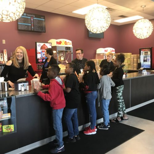 TRIP TO THE THEATER — Area young people had the chance to enjoy an outing to the movies Monday, thanks to the efforts of Assure America, the Tull Family Theater and the Boys 2 Men outreach program.