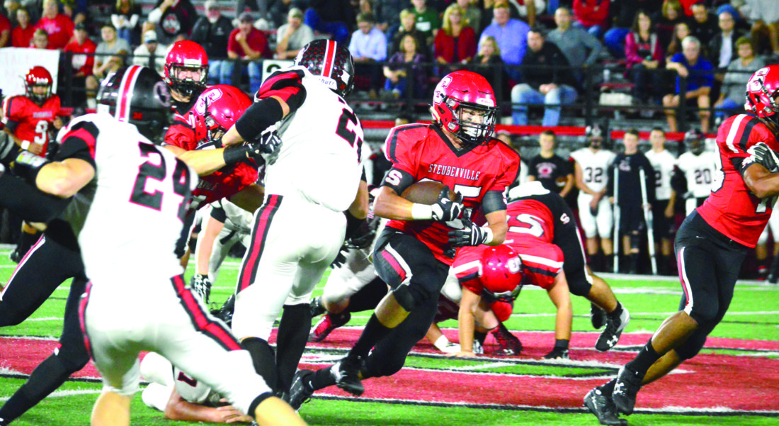 ATTACKING — Steubenville's Jacob Bernard rushes against New Philadelphia on Friday. (Photo by Michael D. McElwain)
