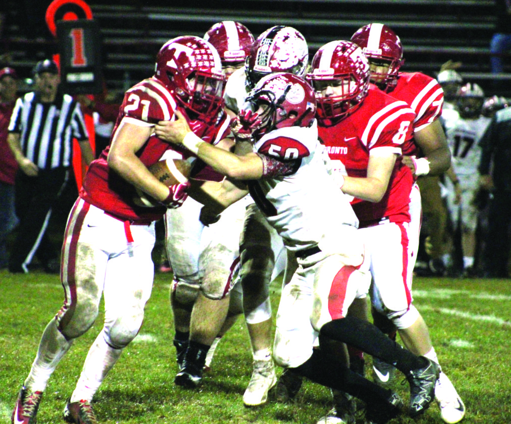 BATTLING — Toronto's Juston Patterson fights for yards against Columbiana's Zach Witherow on Sept. 29. (Photo by Joe Catullo)