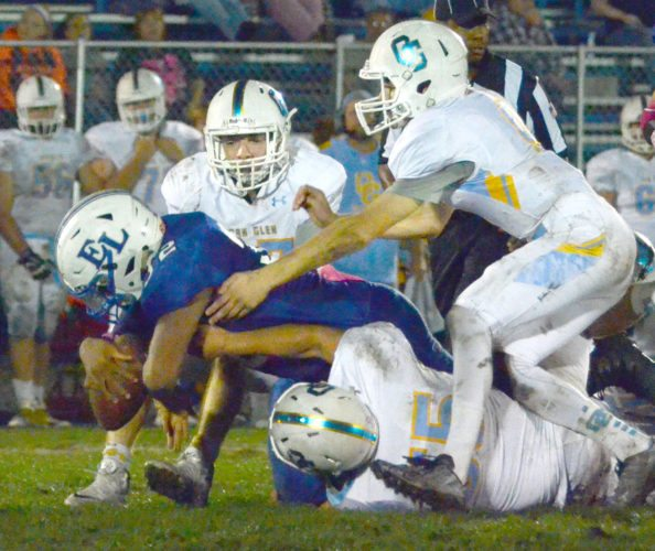 SHUTTING DOWN — Oak Glen's Cameron Reed and Mathias Cook stop East Liverpool's Jalen Moman on Oct. 6. (Photo by Patti Schaeffer)
