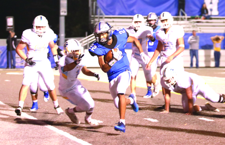 PLENTY OF SPACE — Harrison Central's Tyler West rushes against Oak Glen on Friday. (Photo by Sandi Thompson)