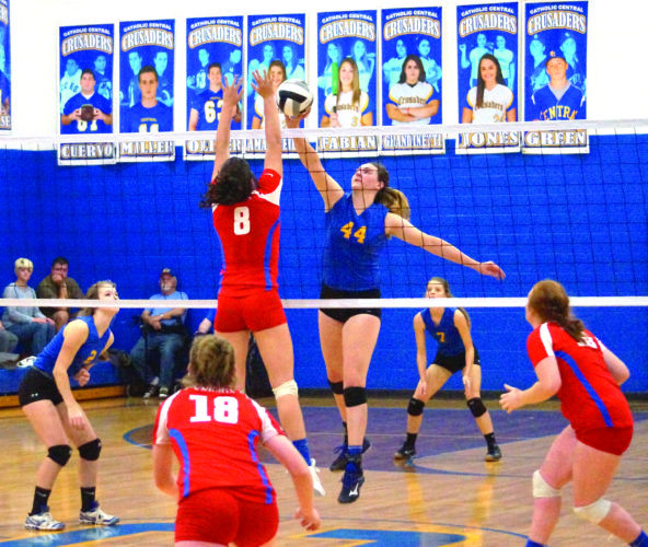 GOING SKY HIGH — Steubenville Catholic Central's Alissa Burchfield attempts a kill over Toronto's Jamie Anderson during a Division IV sectional contest on Wednesday. Also shown is Central's Edy Harold (7). (Photo by Andrew Grimm)