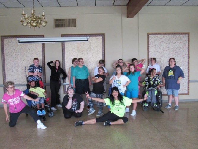 DANCING FUN  — Monica Rogers, center, poses with some of the special needs students who are enjoying a Monday dance program she is teaching at the Steubenville County Club. There also is a dance program on Thursdays at Lisa's Elite Dance in Wintersville. Rogers is the volunteer program coordinator. -- Contributed