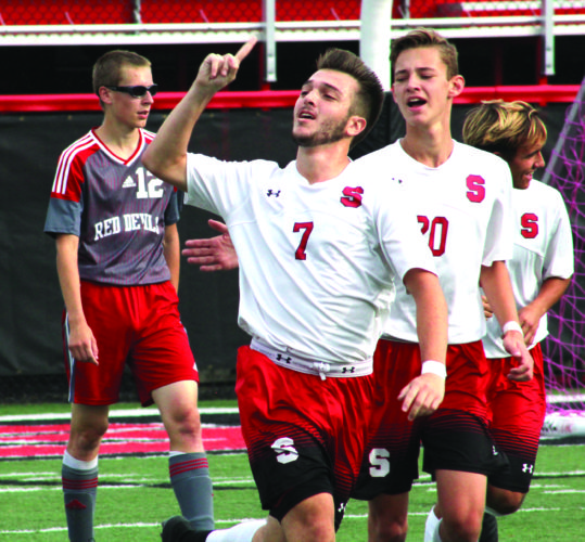 RACING AWAY — Steubenville's Adam DiCarlo (7) celebrates a goal while teammate Jacob Noble (20 follows during a Division II sectional final against St. Clairsville on Saturday. (Photo by Joe Catullo)