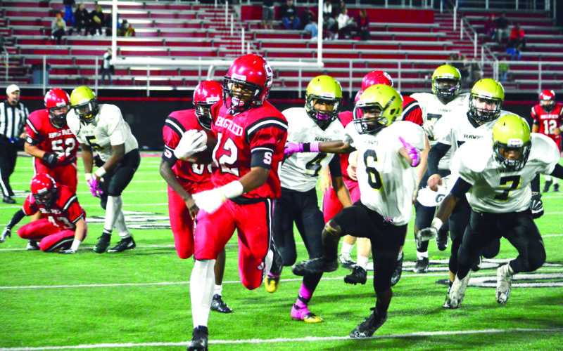 TAKING ADVANTAGE — Steubenville's Jo Jo Brown rushes against Cardinal O'Hara on Friday. (Photo by Michael D. McElwain)