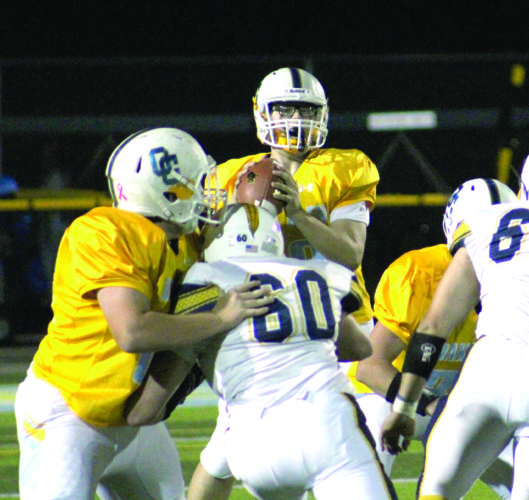 PASSING — Oak Glen's Nick Chaney looks to pass against East Fairmont on Friday. (Photo by Joe Catullo)