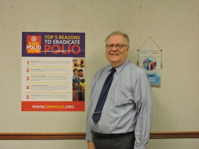 SERVICE ABOVE SELF —  Steubenville Rotary President Alan Hall stands in his office at the Public Library of Steubenville and Jefferson County. Hall said the International Rotary as well as the Steubenville Rotary Club have been working hard for years to eradicate polio cases across the globe.
