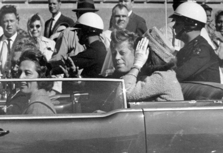 Associated Press JFK IN TEXAS — President John F. Kennedy waves from his car in a motorcade in Dallas. Riding with Kennedy are First Lady Jacqueline Kennedy, right, Nellie Connally, second from left, and her husband, Texas Gov. John Connally at her right.