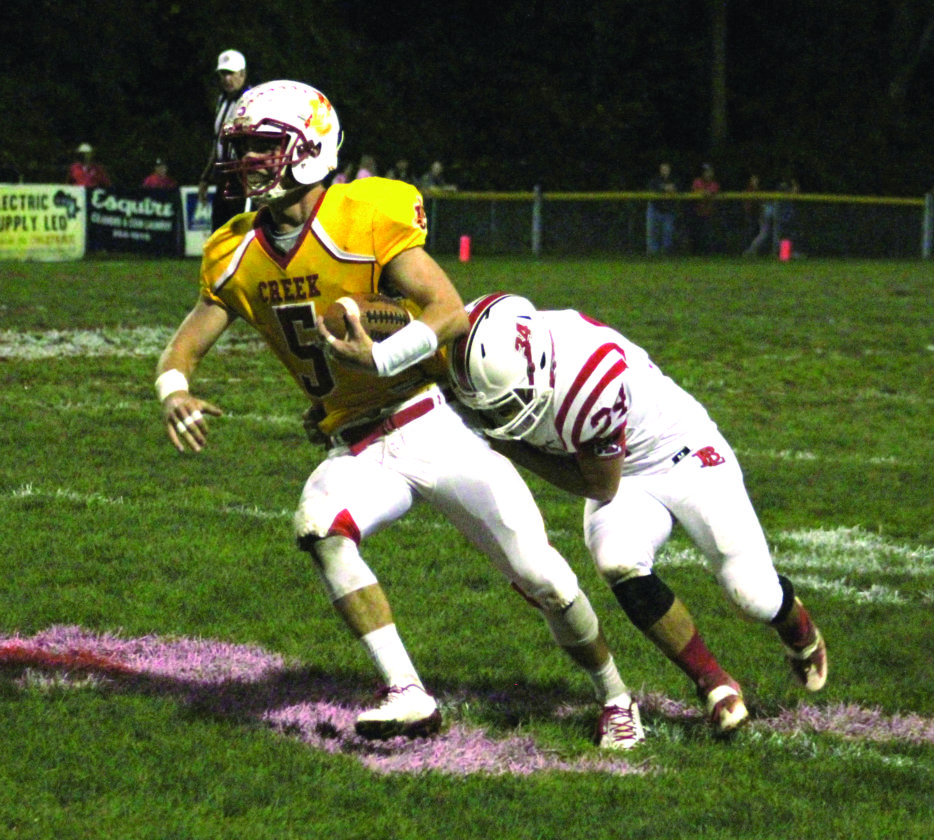 Indian Creek's Derrick Eakle (right) runs after hauling in a pass while Beaver Local's Torey Calio tries to tackle him on Oct. 13. (Photo by Joe Catullo)