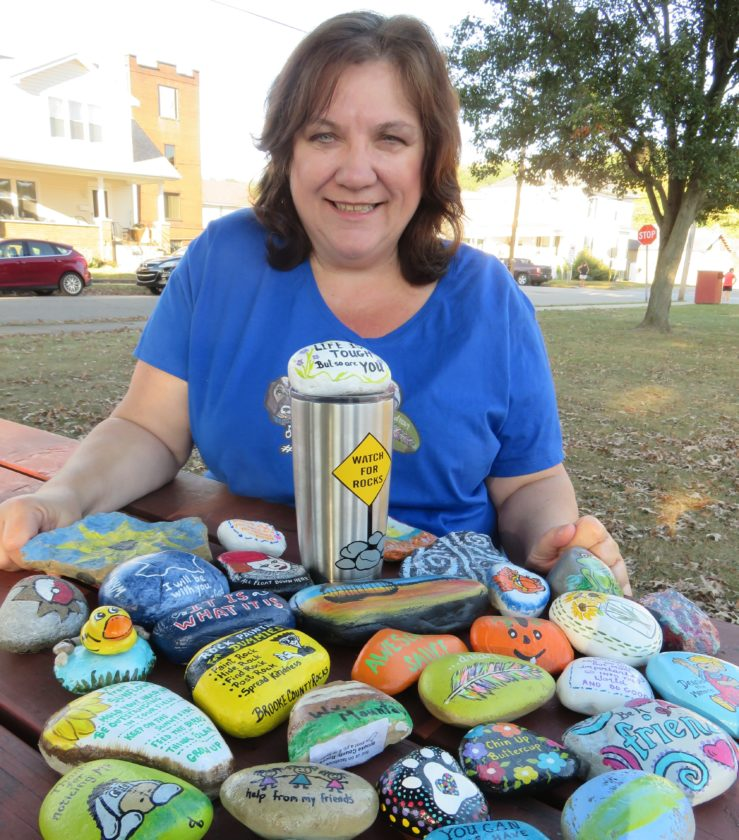 ROCKENTHUSIASTS —  Darla Burns started the Brooke County Rocks group on Facebook in June and has more than 3,800 members on board, interested in painting, hiding, finding and re-hiding the decorated rocks. The hobby for children and adults is a way to spread smiles and brighten someone's day. Burns will host a rock scavenger hunt beginning at 1 p.m. Saturday at the Town Square in Wellsburg.  -- Janice Kiaski