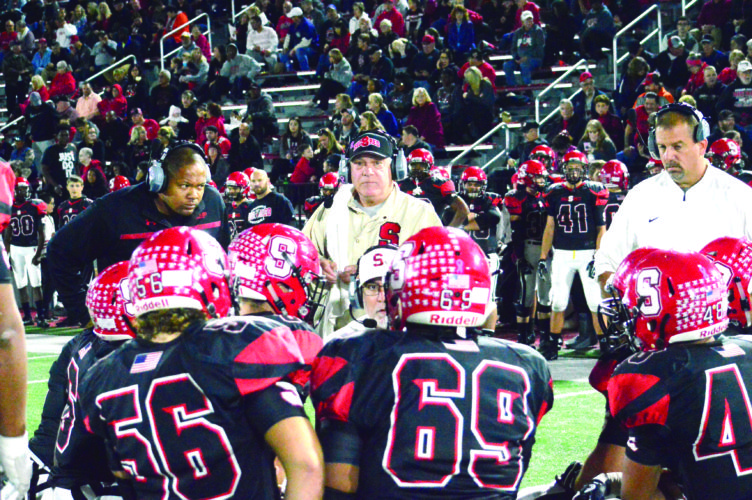 TAKING TIME — Steubenville head coach Reno Saccoccia (center) and his assistants speak with their players during a timeout against University on Friday. (Photo by Michael D. McElwain)