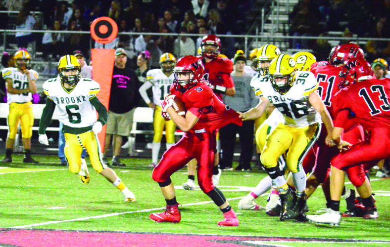 FINDING ROOM — Weir's Chad Custer fights for yards against Brooke on Friday. (Photo by Michael D. McElwain)