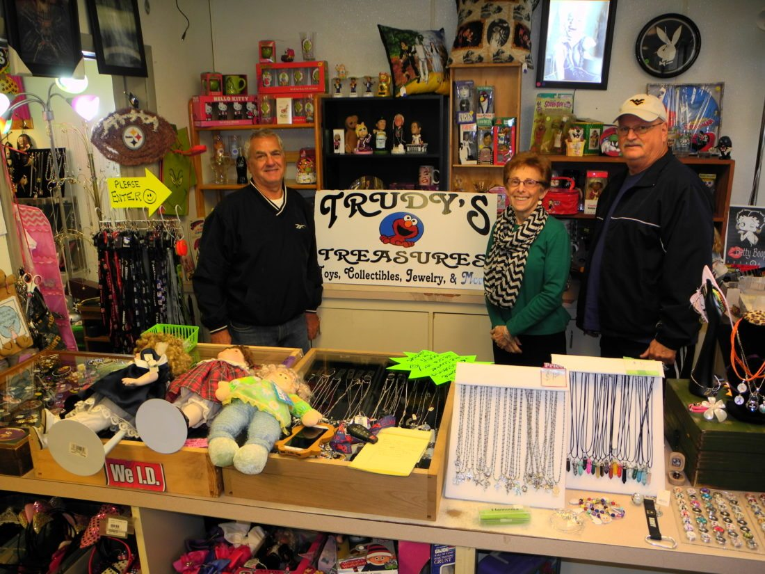 A VARIETY OF MERCHANDISE — Trudy Slaven was visited at her new business, Trudy's Treasures, by Joe Matello, left, and Paul DiGiactino. Slaven has brought a variety of NFL items, jewelry, toys and other collectibles under one roof at Follansbee Plaza on Main Street.