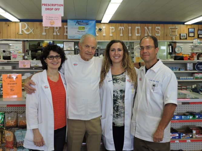 ANILE'S PHARMACY — Standing in Anile's Pharmacy located on Pennsylvania Avenue in Weirton are three generations of pharmacists in the Anile family. They are, from left, Diana Anile-Sikora, Lewis J. Anile, Jessica Jamison and Jeff Anile.