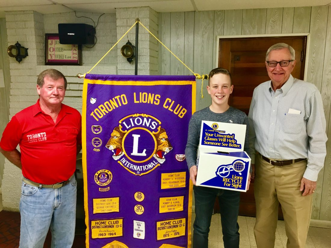 DONATIONMADE — Toronto Lions Club President Art Myers, left, Evan Wolters and Bob Owen, right, Sight-Saving Committee chairman, accepted a donation of more than 240 pairs of eyeglasses collected by Toronto student Evan Wolters as a service project.  -- Contributed