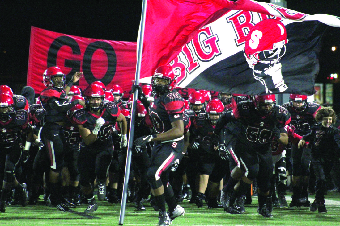 LEADING THE CHARGE — Steubenville's Quentin Moore (50) leads Big Red on the field to challenge Salem in a Division IV, Region 13 quarterfinal on Friday at Harding Stadium. (Photo by Joe Catullo)