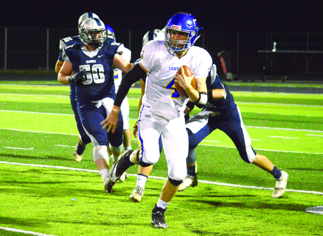 RUNNING HARD — Steubenville Catholic Central's Justin Hartzell rushes by Madonna on Oct. 19. (Photo by Michael D. McElwain)