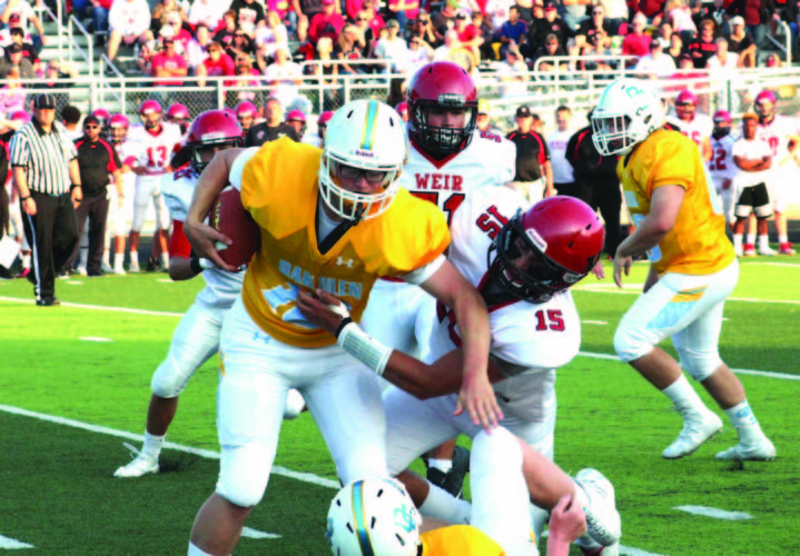 TAKING THE SACK — Weir High's Tyler Komorowski sacks Oak Glen quarterback Nick Chaney on Aug. 25. (Photo by Joe Catullo)