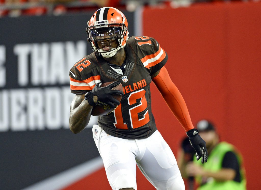 "FILE- In this Aug. 26, 2016, file photo, Cleveland Browns wide receiver Josh Gordon looks on after a touchdown reception against the Tampa Bay Buccaneers during the second quarter of a preseason NFL football game in Tampa, Fla. Gordon declared himself ""clean and sober"" as he embarked on yet another new start with the Cleveland Browns. Gordon spoke about a fresh beginning on Wednesday, Nov. 8, 2017, one week after NFL Commissioner Roger Goodell conditionally reinstated the oft-suspended former Pro Bowl wide receiver who recently said he never played in a game without drinking or taking drugs before it.  (AP Photo/Jason Behnken, File)"