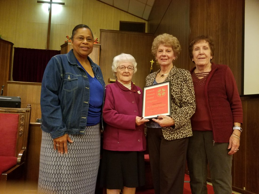 "EVENT HIGHLIGHTS — Diane Pastoric, second from right, received the Valiant Woman award when the Weirton Unit of Church Women United held its World Community Day worship service Nov. 3. With Pastoric are, from left, Rebecca ""Tish"" Turner, coordinator; Isobel Bell, Valiant Woman committee member; and Helen Tate, committee chair.  -- Contributed"