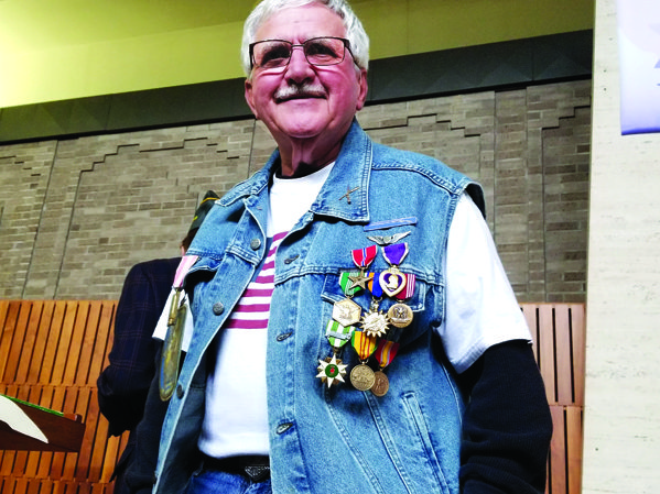 SERVICE ON  DISPLAY — Though he said he doesn't fit in his dress blues anymore, Michael Bongart of Toronto displayed his medals for service in the Vietnam War, including a Purple Heart, a Bronze Star and an Air Medal, on a motorcycle vest he wore on a military veterans Rolling Thunder ride in Washington, D.C., in 2001. Bongart wore his medals as he gave a talk about his service during an event held by AMVETS Post 275 and American Legion Post 557 Friday afternoon at the Prime Time center on Lovers Lane Friday afternoon.
