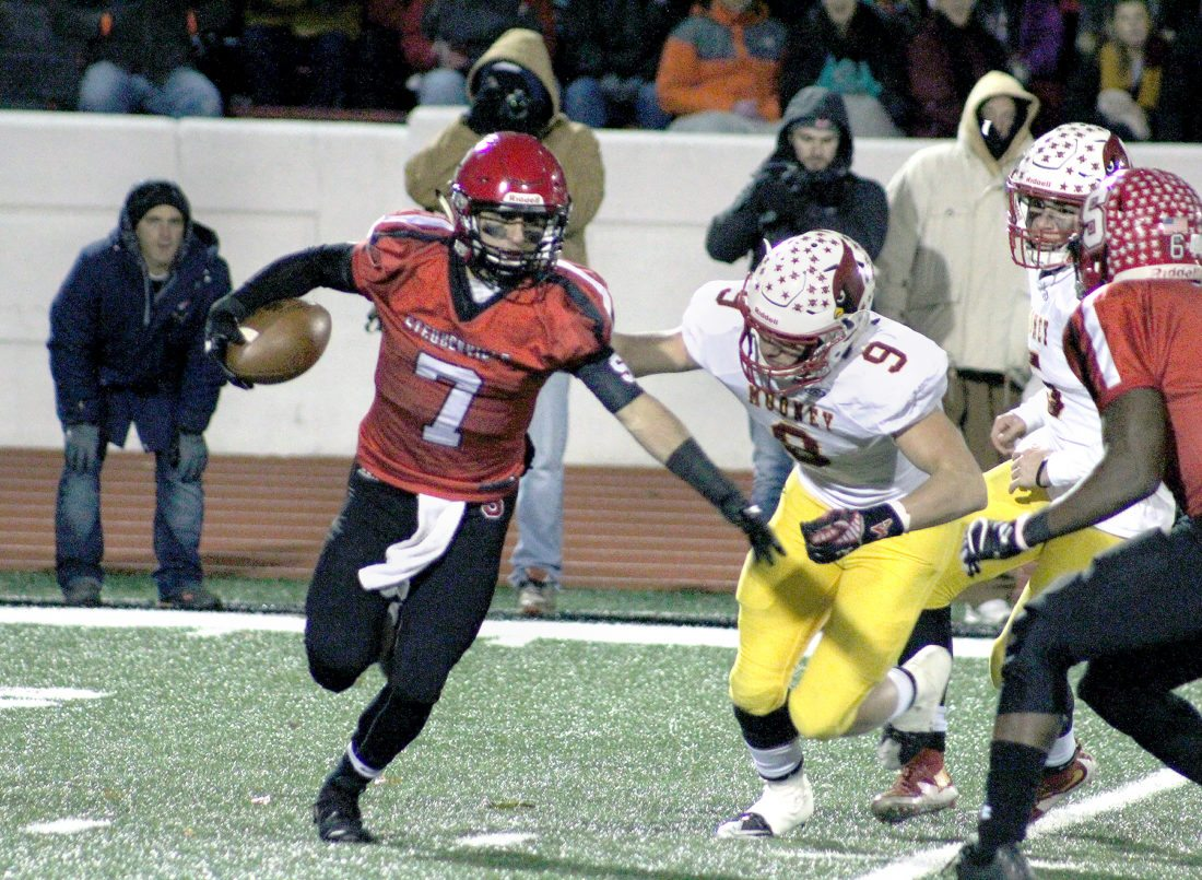 ROLLINGON — At left, Big Red's Gino Pierro returns a punt against Cardinal Mooney. (Photo by Joe Catullo)