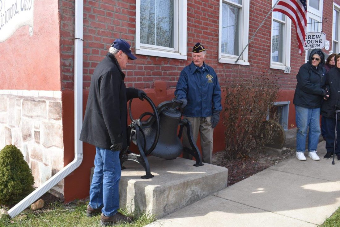RINGING THE BELL — Veterans Day in Richmond brought the ringing of the old schoolhouse bell outside the Crew House Museum on Main Street when the clock noted 11 a.m. Nov. 11. The bell was rung by veterans Don Swickard, left, vice president of the Richmond Community Historical Society, event organizer, and Korean War veteran Tom Grimm, who at 62 years is the longest serving member of the Richmond American Legion Post 740, Honored Seven.  -- Contributed