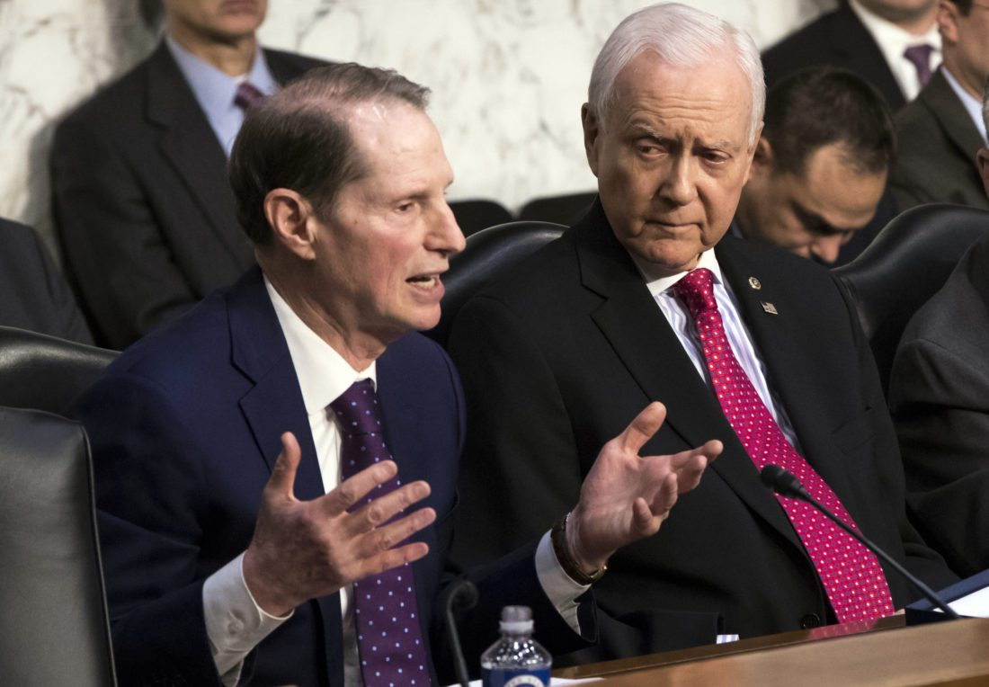 TAX WORK CONTINUES — Sen. Ron Wyden, D-Ore., left, the top Democrat on the Senate Finance Committee, criticizes the Republican tax reform plan while Chairman Orrin Hatch, R-Utah, listens to his opening statement as the panel begins work overhauling the nation's tax code, on Capitol Hill in Washington on Monday. The legislation in the House and Senate carries high political stakes for President Donald Trump and Republican leaders in Congress, who view passage of tax cuts as critical to the GOP's success at the polls next year. -- Associated Press