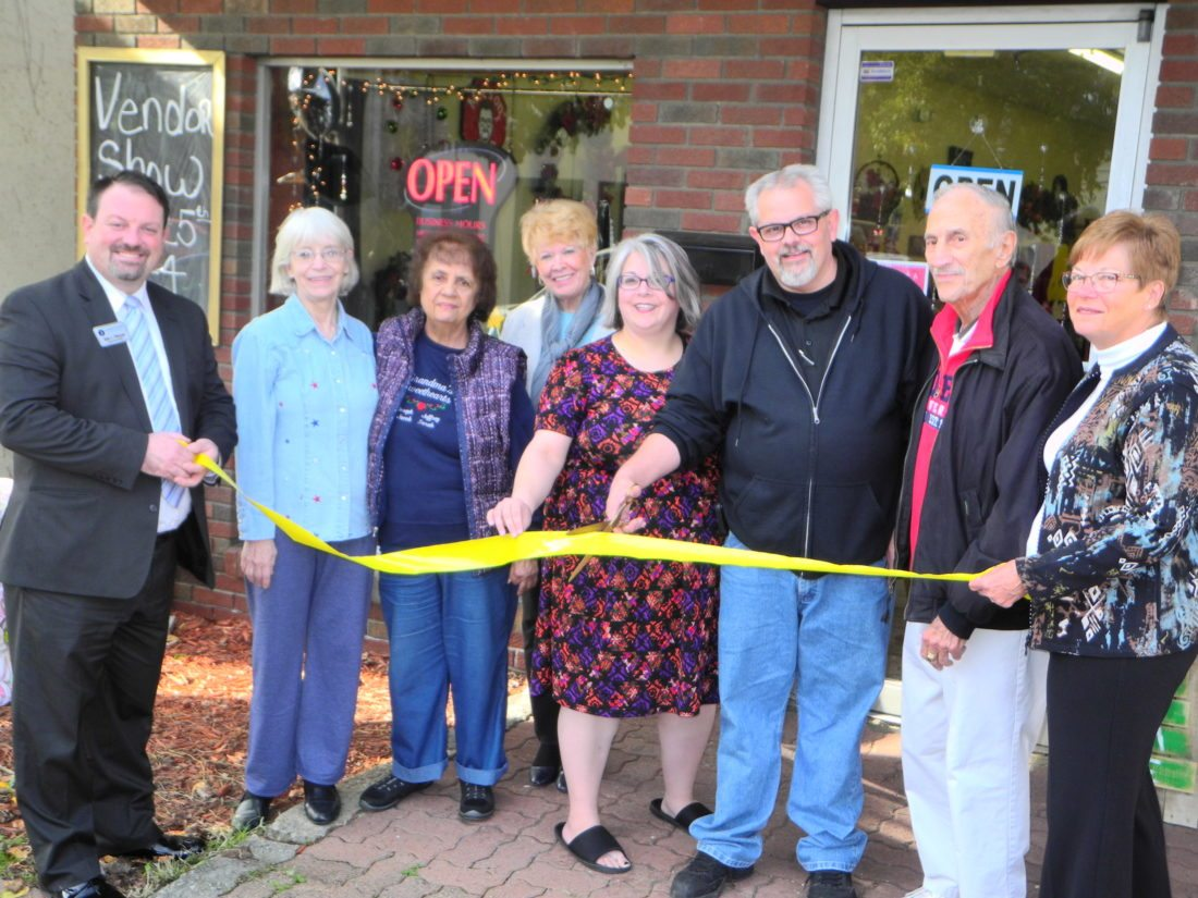 "UNIQUE CRAFTS OFFERED — Recently opened at 1031 Main St., Follansbee, Moe's on Main offers a variety of unique handmade crafts. The new shop is owned by Elmer ""Moe"" Myers and his wife, Monica Rotellini-Myers. On hand for a ribbon cutting to celebrate the shop's opening.  were, from left, chamber member Eric Fithyan; Monica's mother, Carol Boyce; chamber members Carmel Esposito and Pat Accetollo; the Myers; Chamber President Tony Paesano; and chamber member Charlotte Kolenc. - Warren Scott"