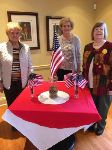 REMEMBERING VETERANS — The Fidelis Gamma Chapter of Alpha Delta Kappa's November meeting included a tribute to veterans. With the flag display are, from left, Past President Carolyn Allison, President Ruth Fuller and President-Elect Chris Snyder. -- Contributed