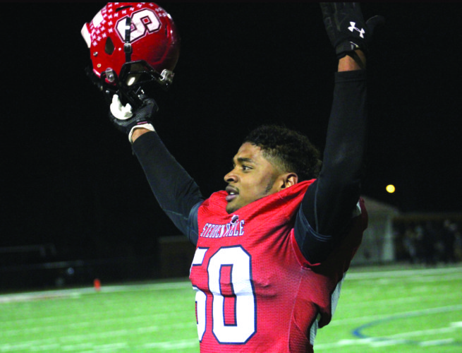 GETTING THE CROWD INVOLVED — Steubenville's Quentin Moore celebrates after Big Red clinched the Division IV, Region 13 title against Perry on Friday in Niles. (Photo by Joe Catullo)