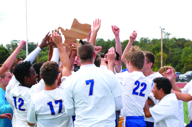 CROWNING CHAMPIONS — The Steubenville Catholic Central boys soccer team celebrates winning an OVAC title agaisnt Linsly on Sept. 30. (Photo by Andrew Grimm)