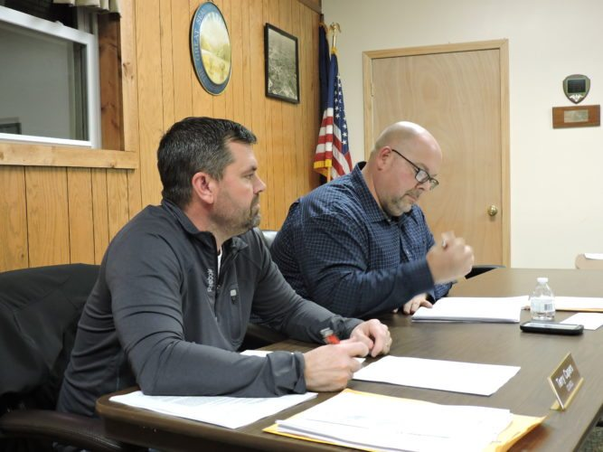 LISTENING — Cadiz Village Council members Terry Capers, left, and Mike McPeak listen to a speaker at Thursday's council meeting. -- Dylan McKenzie