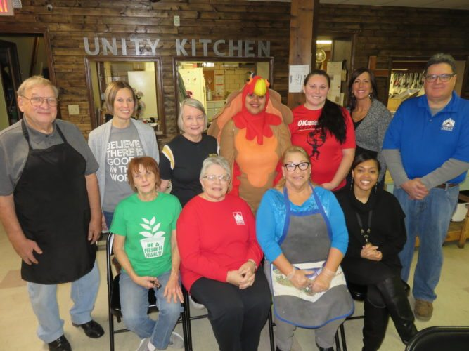 GROUP EFFORT — Urban Mission Ministries representatives who are thankful for the public's support in making Thanksgiving a better experience for the less fortunate are, seated, from left, Joyce Guglielmo, Unity Kitchen coordinator; Linda Costello, hunger services director; volunteer Marsha Gibson; and Cynthia Lytle, community developer: and standing, the Rev. Gene Chadwell of Community of Christ Church in Follansbee, volunteer; Amber Wade, mission financial director; Sharon Miller, volunteer; Vanessa Slappy, office manager and one of the mission's Thom Turkey presenters; Sara Montgomery, custodian; Kelly Jeffers, director of new initiatives; and Rick Patterson, warehouse director. The mission is providing a Thanksgiving meal to more than 1,000 families through its Client Choice Food Pantry program and will serve a hot holiday meal to at least 100 people on Wednesday at the Unity Kitchen, beginning at noon. -- Janice Kiaski