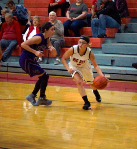LEADINGTHEWAY — Big Red's Seana Ragusa dribbles past Martins Ferry's Madison Ging during Thursday's win over the Purple Riders inside the Crimson Gym. Ragusa led the way for Big Red with 15 points. (Photo by Andrew Grimm)