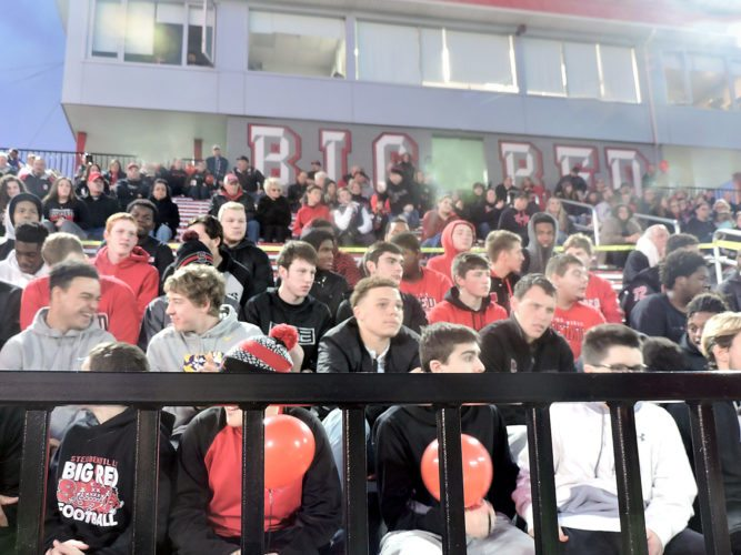 THE MEN OF BIG RED — The Steubenville High School football players sat with their families, friends and fans in the stands at Harding Stadium Friday night during a final pep rally prior to today's state championship game in Canton against Clinton-Massie. - Dave Gossett