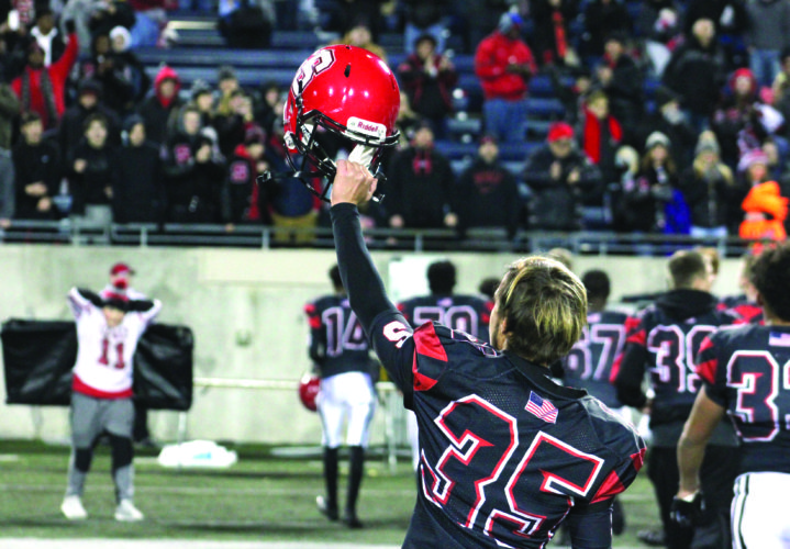SALUTING — Steubenville's Ian Phillips motions to the crowd after Big Red defeated Shelby in a Division state semifinal on Nov. 24 in Akron. (Photo by Joe Catullo)