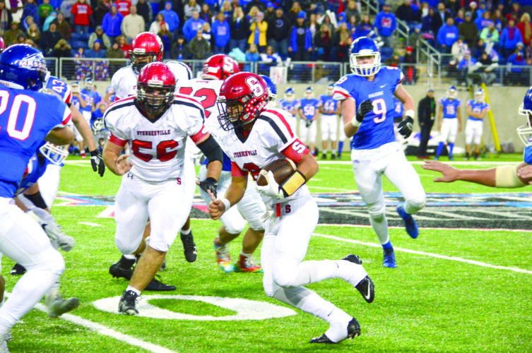 RUNNING BY — Steubenville's Javon Davis rushes against Clinton-Massie while Aliiah Demitras (56) looks to block during the Division IV state final on Saturday in Canton. (Photo by Michael D. McElwain)