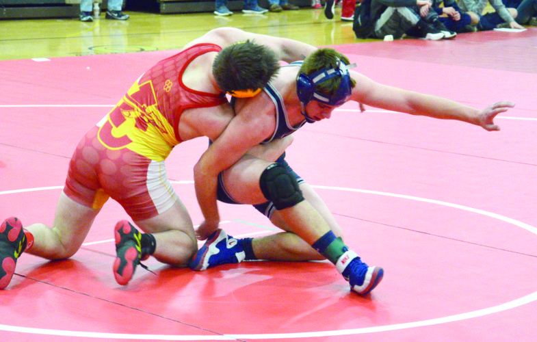 WRESTLING — Madonna's Garrett Cook tries to get away from Indian Creek's Logan Wilson at 182 pounds during the Rick Link tournament on Saturday. (Photo by Kim North)