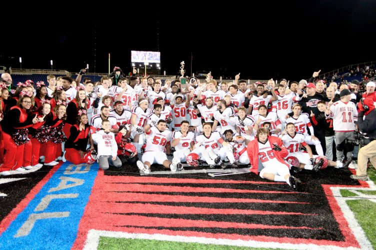 Members of the Steubenville High School football team and cheerleaders are all smiles after the trophy presentation following  the team's 50-36 victory over Clinton-Massie to capture the 2017 Division IV state championship. - Michael D. McElwain