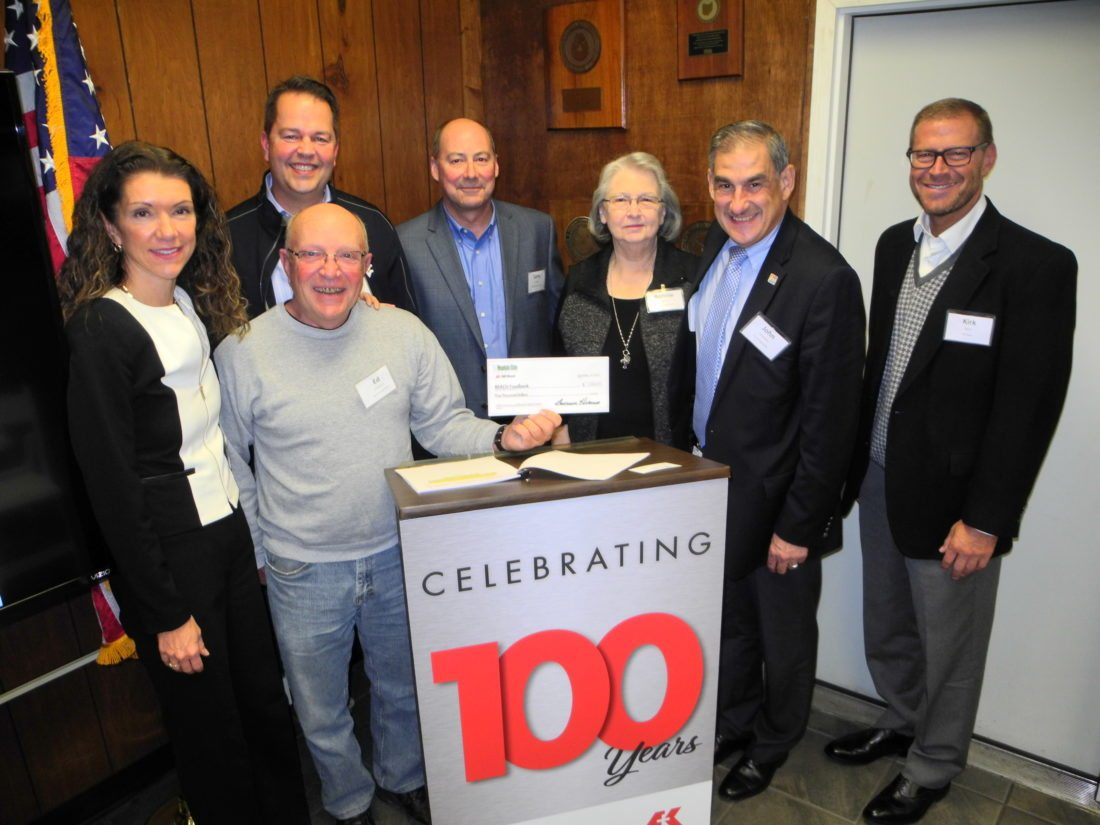 CELEBRATING ACENTURY — Officials with AK Steel and Mountain State Carbon celebrated the 100th anniversary of the Follansbee coke plant by making a $5,000 donation to the Follansbee R.E.A.C.H. Program, a local food pantry. On hand for the presentation were, from left, Renee Filiatraut, vice president of external relations for AK Steel; Ed Wilkerson, chairman of the food pantry's board; Mayor David Velegol Jr.; Larry Hermes, operations manager for AK Steel and vice president and chief financial officer for Mountain State Carbon; Bonnie James, volunteer director of the food pantry; City Manager John DeStefano; and Kirk Reich, president and chief operating officer of AK Steel. -- Warren Scott