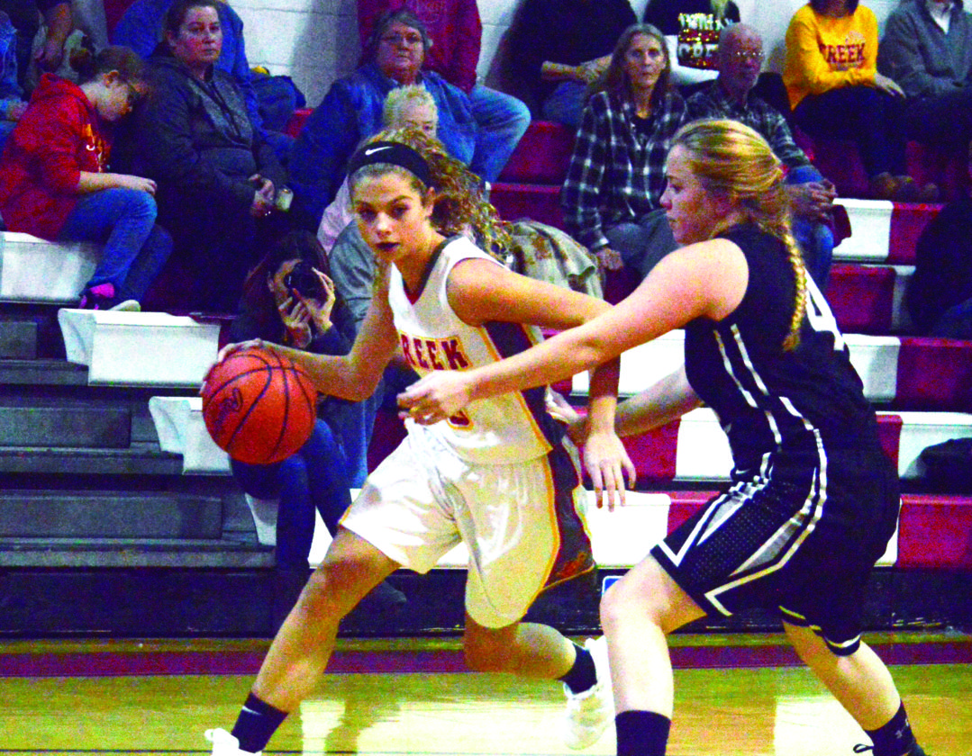 DRIVING — Indian Creek's Kylie Kiger drives past Edison's Maddie Brenstuhl on Monday. (Photo by Joe Catullo)