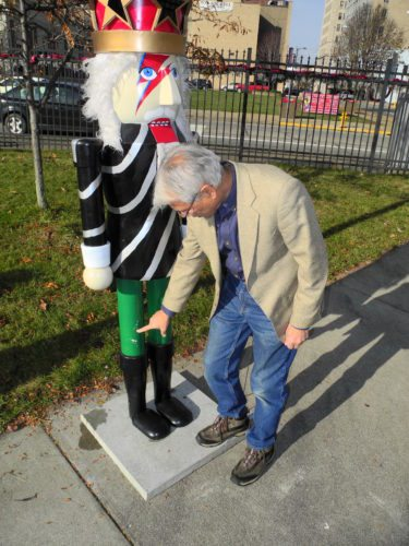RETURNED — Jerry Barilla, president of Historic Fort Steuben, points to one of two areas where paint was scraped from the Starman nutcracker when it was taken from the Nutcracker Village on Saturday. Barilla said he is thankful the nutcracker was returned by the pair who face charges of theft in Steubenville Municipal Court in connection with its disappearance. -- Warren Scott