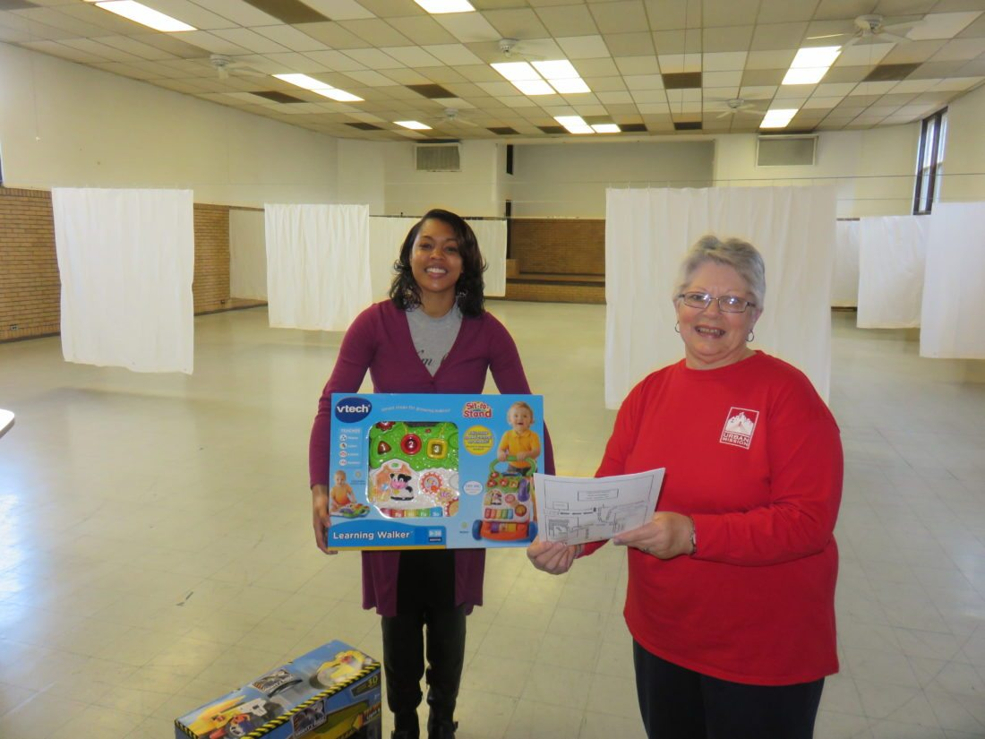 FILL THIS ROOM — Although it's empty now, this room at Urban Mission Ministries' War Memorial Building at 423 North St., Steubenville, hopefully will be filled to accommodate Christmas giving needs for 1,120 children ages 12 and younger and teens, with distribution starting next week. Cynthia Lytle, left, community developer, and Linda Costello, hunger services director, say they and the mission staff embrace faith to meet the yet-to-be-fulfilled level of need for toys and teen toiletry items.   -- Janice Kiaski